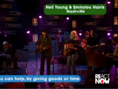 react-now-neil-young-emmylou-harris-old-guitar1-091005.jpg